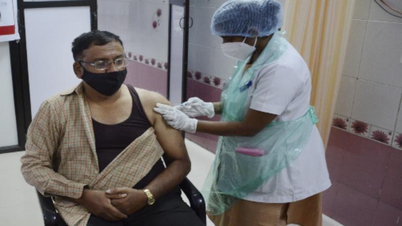 Man taking a vaccination jab